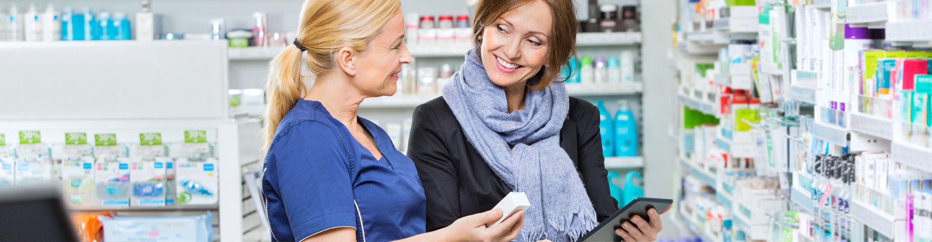 pharmacist and customer smiling at each other